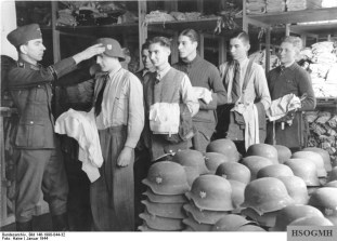 Recruits for the Großdeutschland Division are kitted out with uniform in 1944.