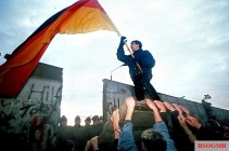 Celebration with East German Border Guards looking on.