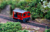 Little model railroad car on tracks