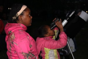 Mother and daughter at a telescope