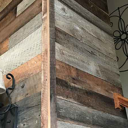 Maryville, TN private residence – Reclaimed Barn Wood for chimney surround. Customer selected a mix of 60% brown, 40% gray unfinished.