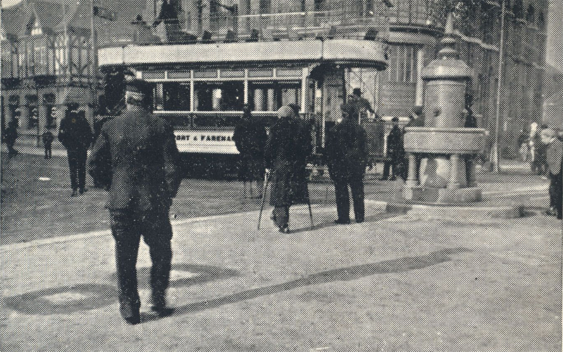 A tram waiting next to the Gambier fountain