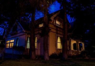 Historic Harris House at night.