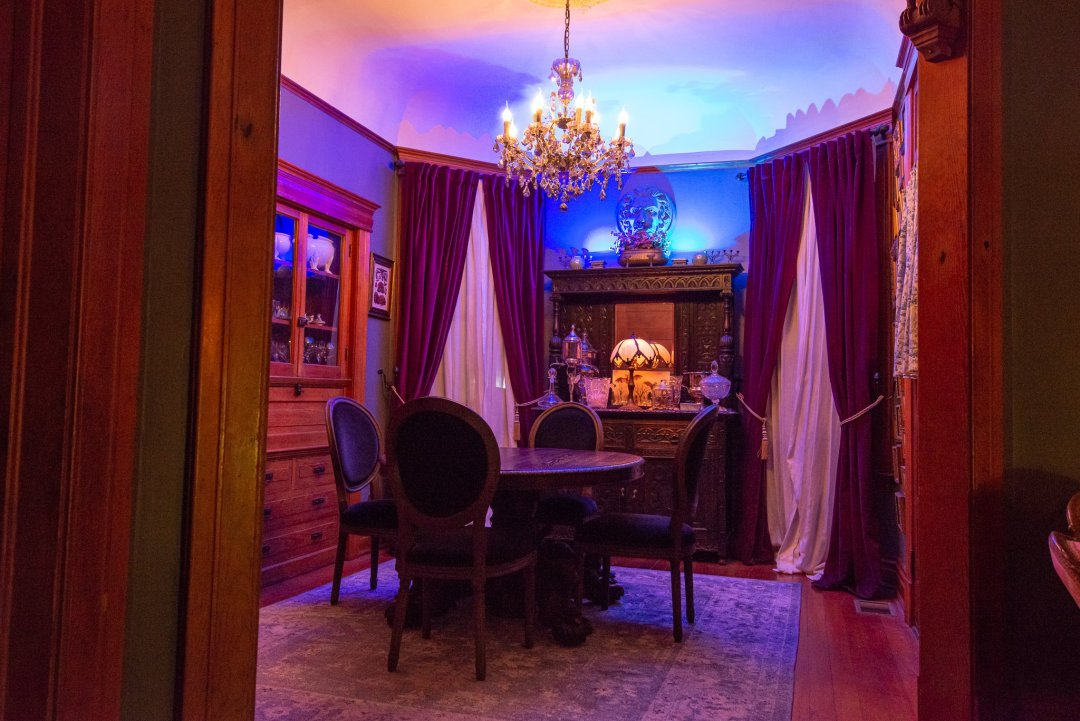 The Victorian Dining Room with Crystal Chandelier at Night.