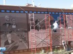 By late September 2007, the mural had progressed into recent decades.