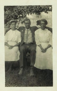 Two Young Women and Man Seated