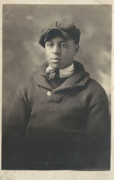 Youth in Sweater and Cap