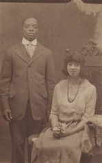 Young Couple - Man Standing Woman Seated