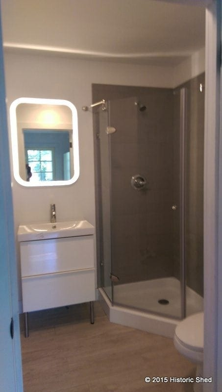 """The 5'-6""""x5'-6"""" bath has a shower, vanity and toilet, as well as a washer/dryer closet"""