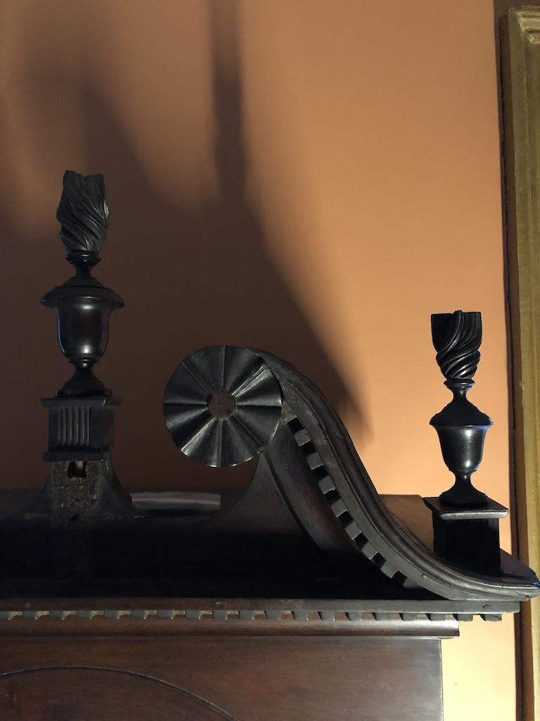 Close-up Shot of Hood Finial Details on Antique Grandfather Clock