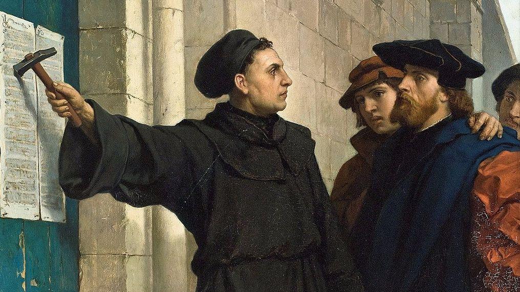 Ferdinand Pauwels, 1872. Maarten Luther spijkert de 95 stellingen op de deur van de slotkerk in Wittenberg, 31 oktober 1517. (wiki)