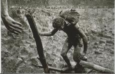 Sebastiao Salgado; Brazil: Transporting bags of dirt in the Serra Pelada gold mine; 1986