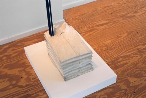 Doris Salcedo; Untitled; 1989-1993; nine cloth shirts, plaster, steel; 66.4 x 10.5 x 16 inches