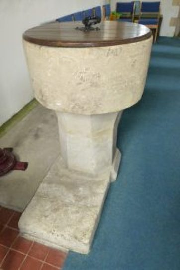 Stone font circa 13th or 14th century