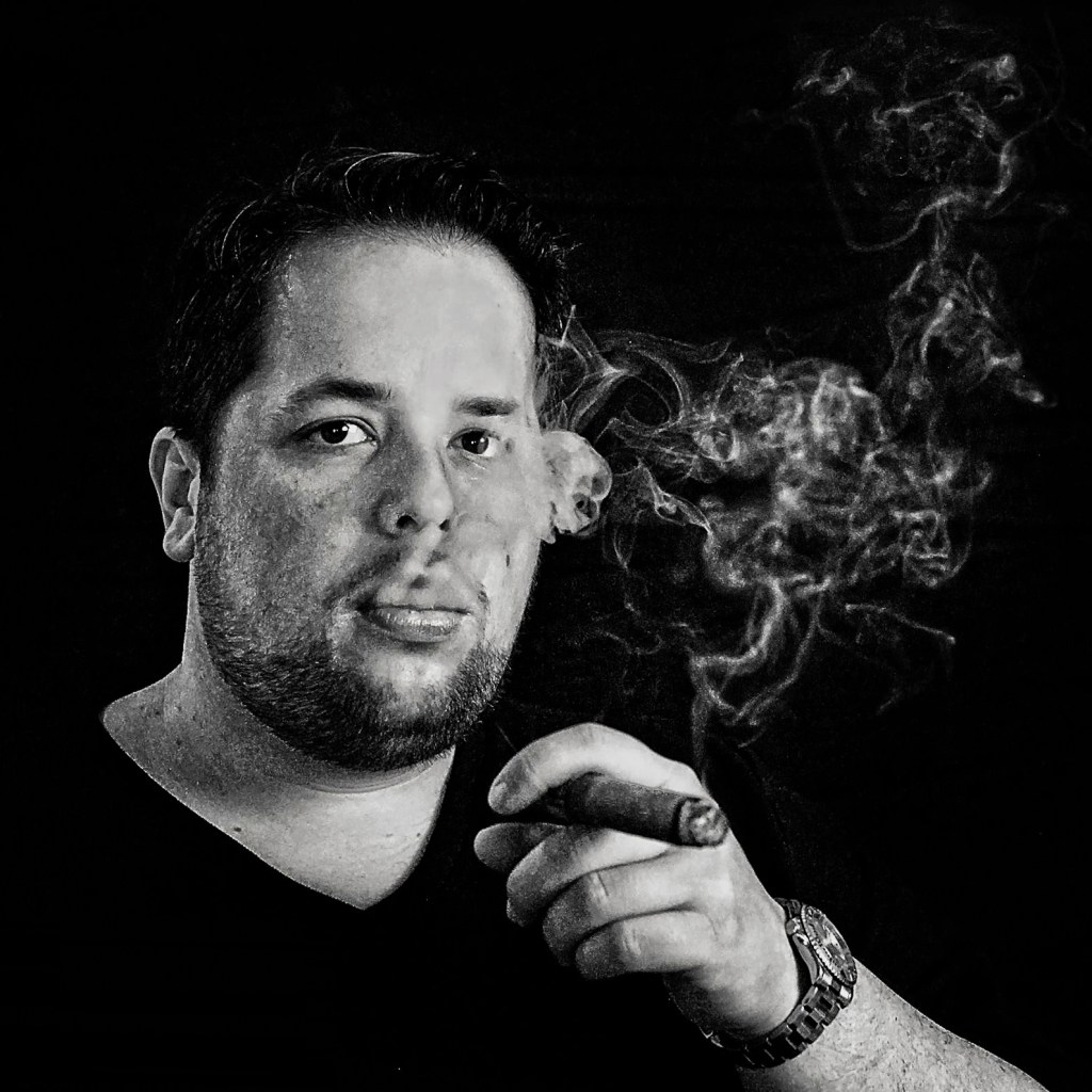 Jesse Friedman smoking a cigar deep in thought