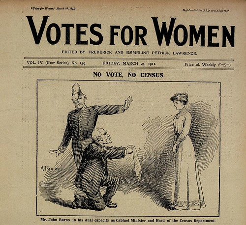 Votes for Women front page showing the head of the census department kneeling in front of a suffragette.