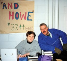 "Ringette Calgary Board Members Laura Webb and Paul Peters work the table selling ""And Howe"" books."