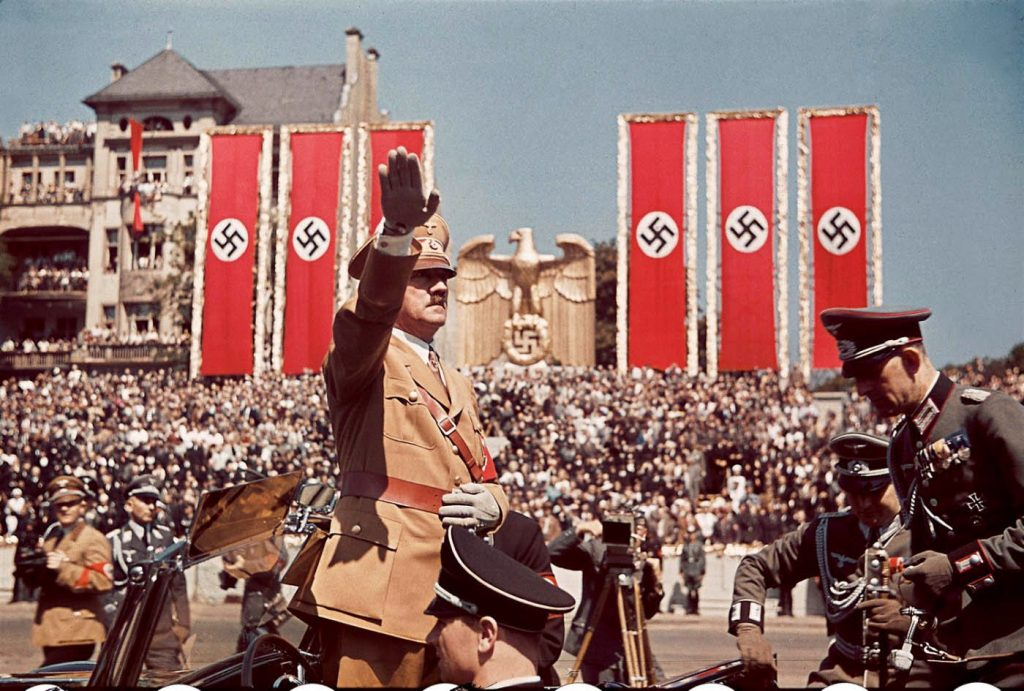 Adolf Hitler salutes troops of the Condor Legion who fought alongside Spanish Nationalists in the Spanish Civil War, during a rally upon their return to Germany, 1939