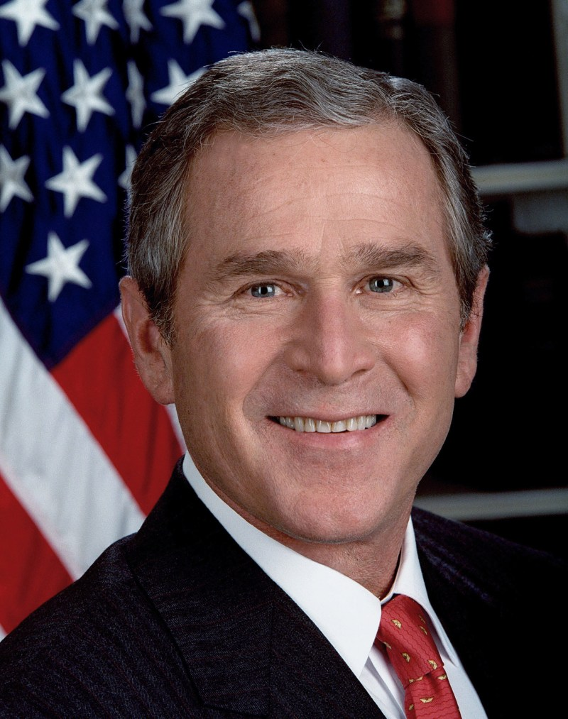 President George Bush looking at the Camera and smiling