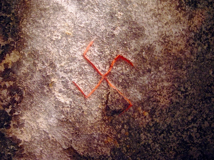 Swastika carved into the Snoldelev Stone from the 9th century. It was used over a thousand years before Nazi Germany existed.