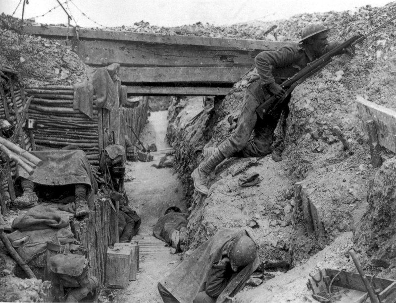 Soldiers inside of a German trench during the Battle of the Somme in the First World War in July 1917. You can see a soldier keeping look out as others sleep.