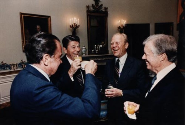 Four Presidents in the White House Blue Room in October 1981. All are in suits and are smiling.