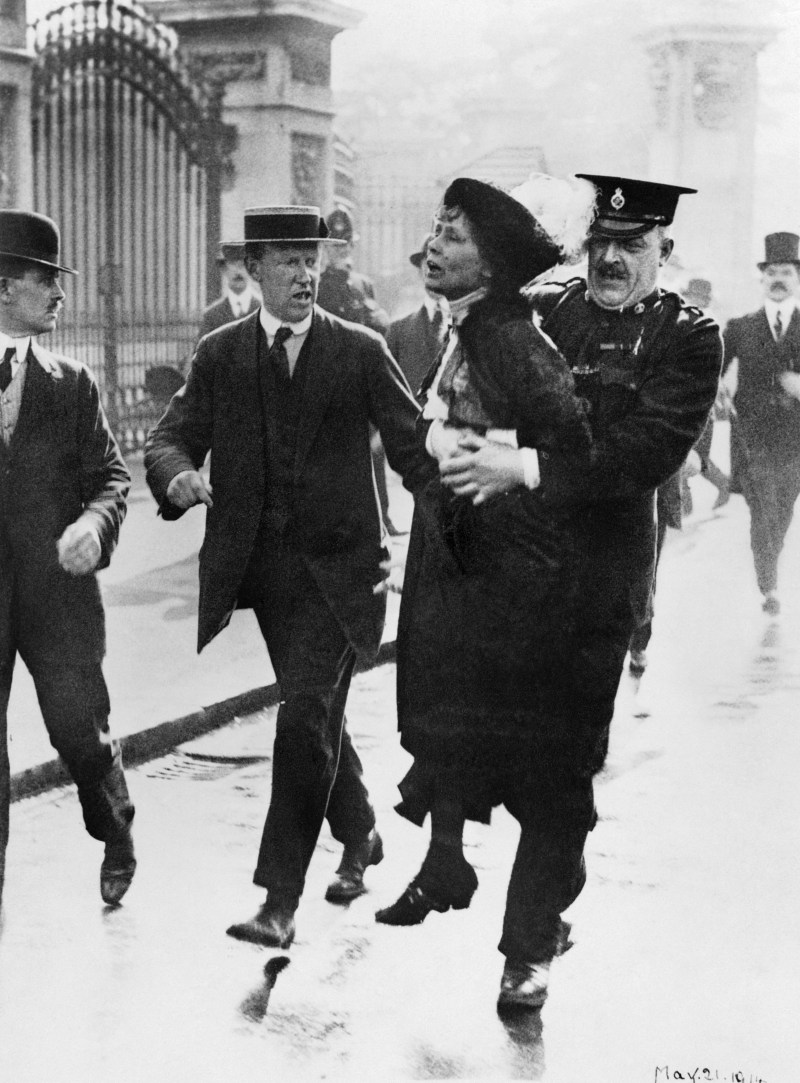 Emmeline Pankhurst being carried away from Buckingham Palace by a police officer in May 1914.