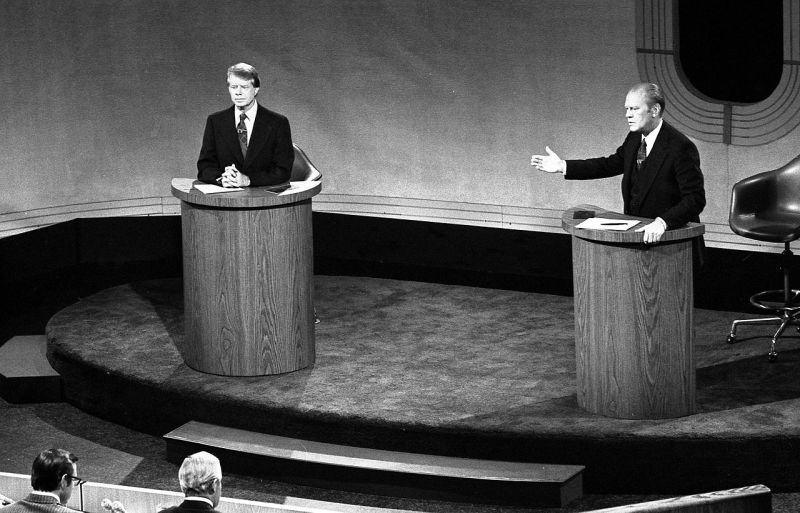Jimmy Carter and Gerald Ford debating in front of an audience at the first of 3 Ford-Carter presidential debates.