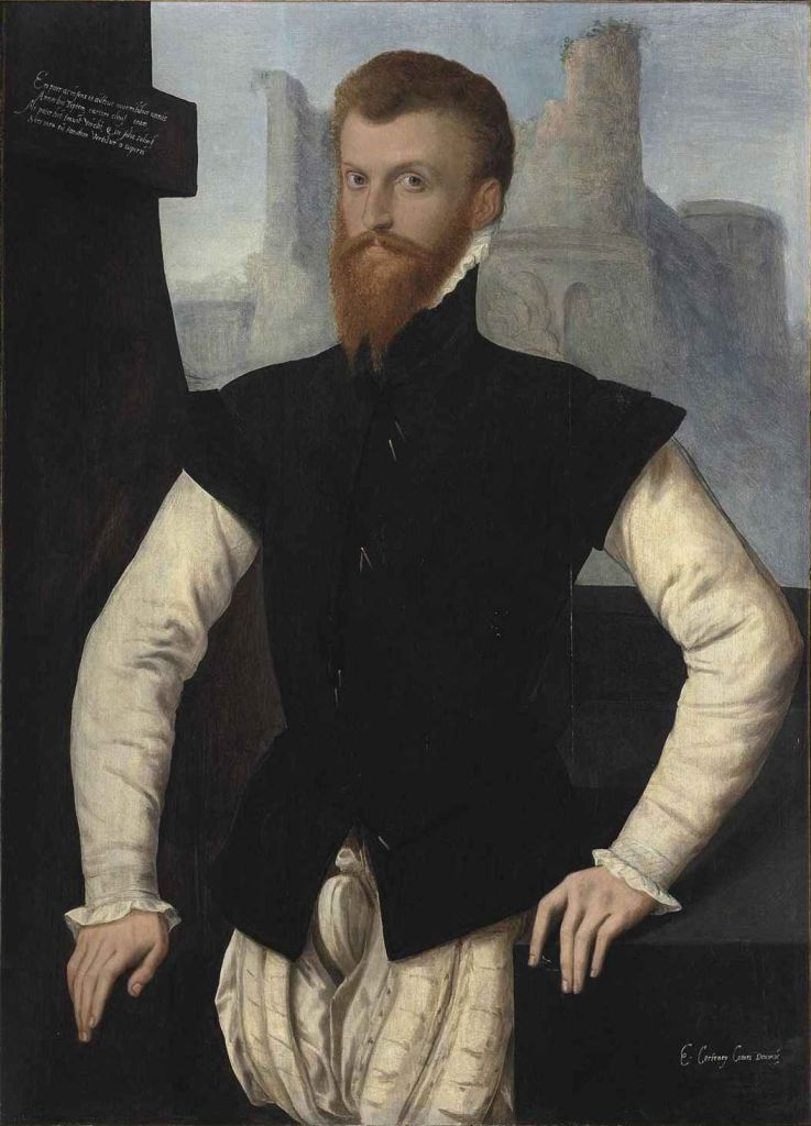 A tudor man in front of a castle wearing theusual clothing of a tudor nobleman at the time.