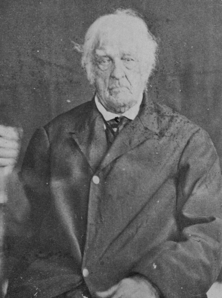 Photograph of American Revolutionary War veteran, Lemuel Cook, at the age of 104 wearing formal clothing in 1864.