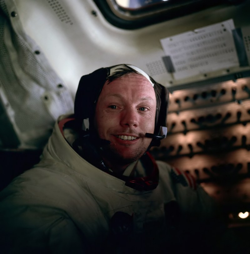Neil Armstrong smiling at the camera after the completion of the first Lunar EVA in July 1969