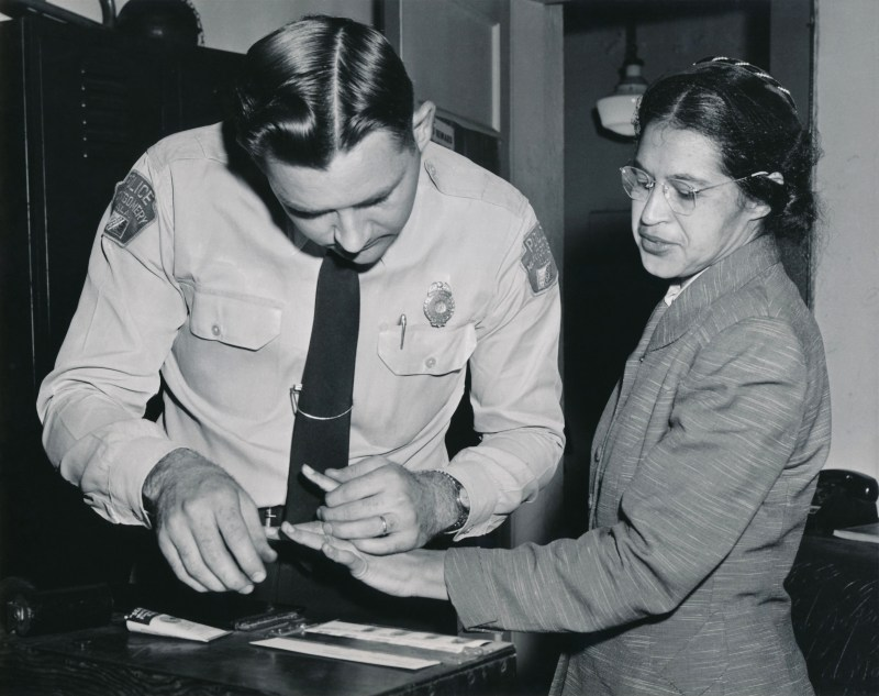 Rosa Parks being fingerprinted by Police officer Lieutenant D. H. Lackey in February 1956.