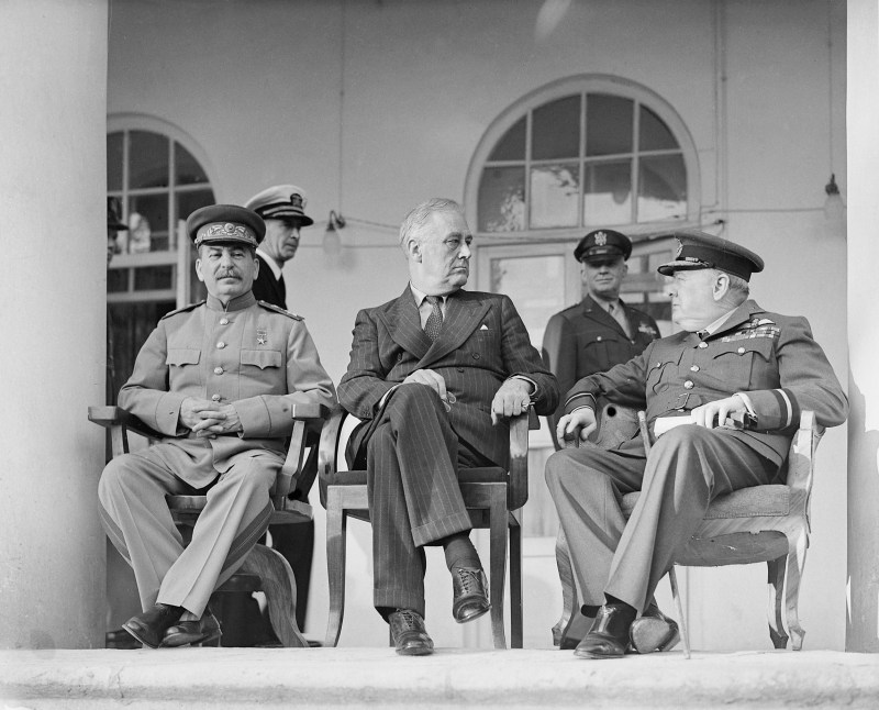 Josef Stalin, Franklin D. Roosevelt, and Winston Churchill sitting for a photograph at the Tehran Conference in November 1943.