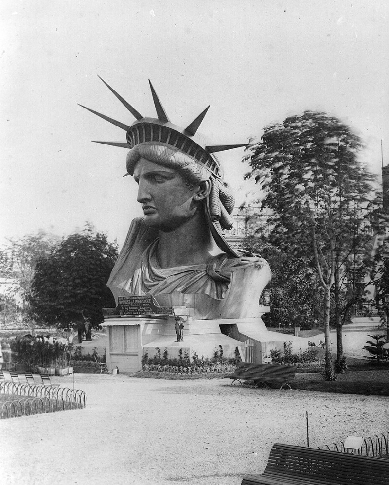 The head of the Statue of Liberty on display in a park in Paris, France at the World Fair in 1878.