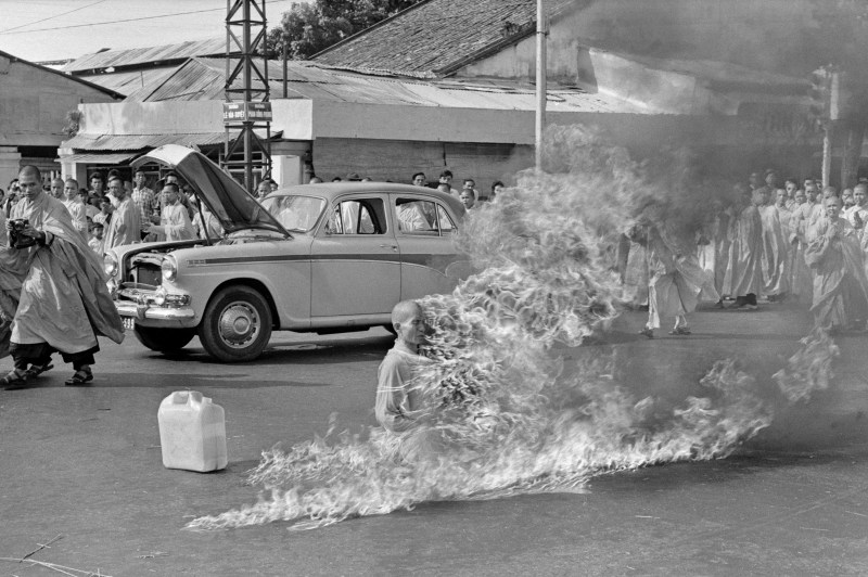 Photograph of Thích Quảng Đức's self-immolation. You can see him on fire on a street in saigon in June 1963