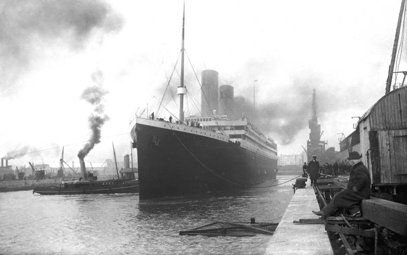 The titanic in the port of Southampton on the 12th April 1912. People can be seen looking at the ship as it prepares to leave.