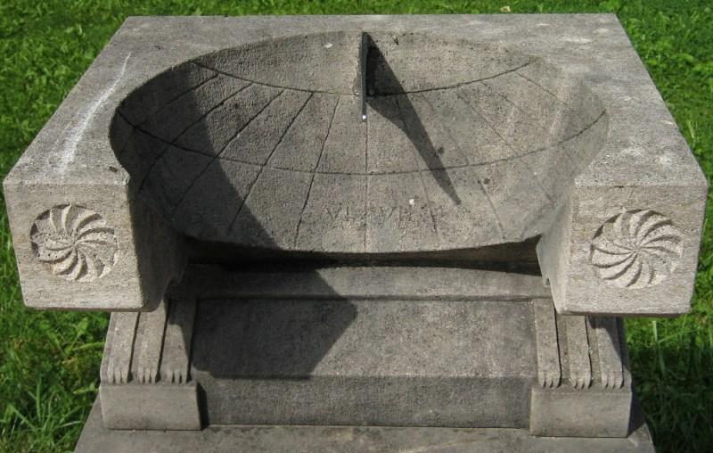 a stone roman basin sundial