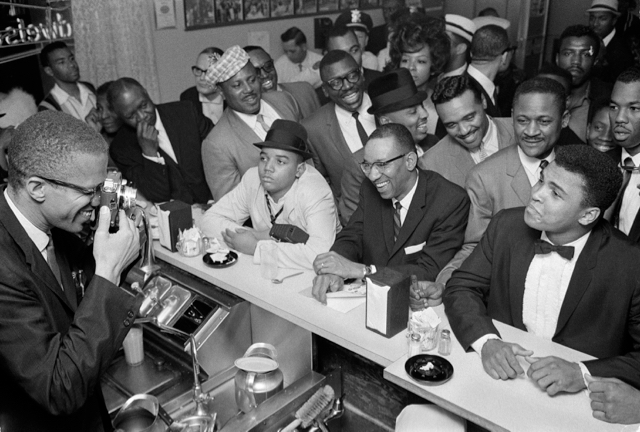 Malcolm X photographing Muhammad Ali