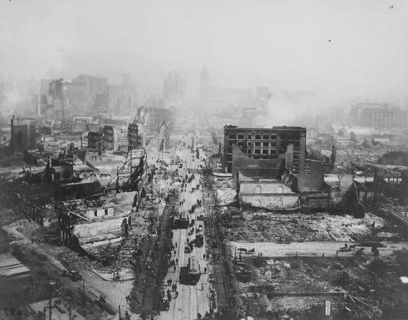 The ruins of San Francisco, still smoldering after the 1906 earthquake, taken from the tower of the Union Ferry Building. Market Street between Sacramento and Third Streets