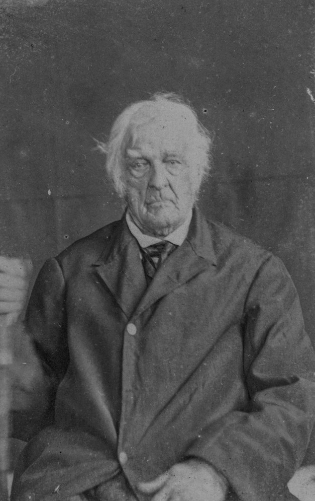 Lemuel Cook, aged 105, in a coat in 1864. He is a veteran of the Revolutionary War.