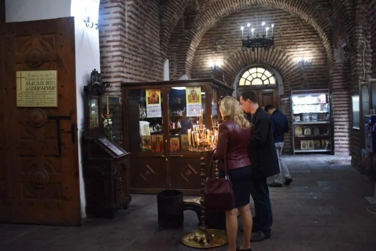 The original photograph of a couple lighting prayer candles in St Sofia
