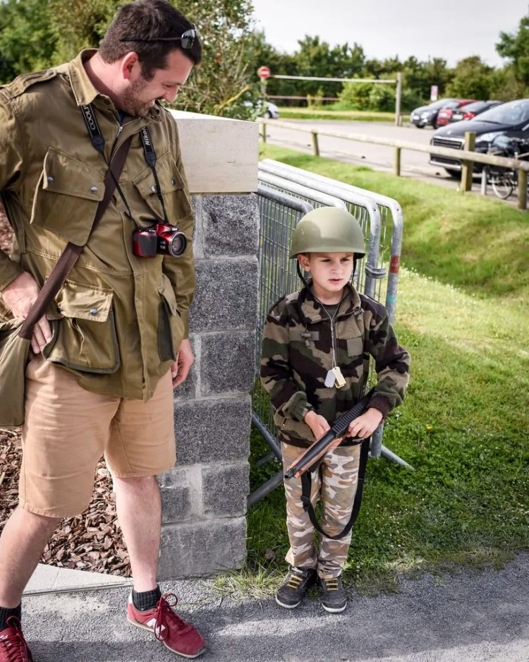 A young reenactor and his Dad at Ponte du Hoc