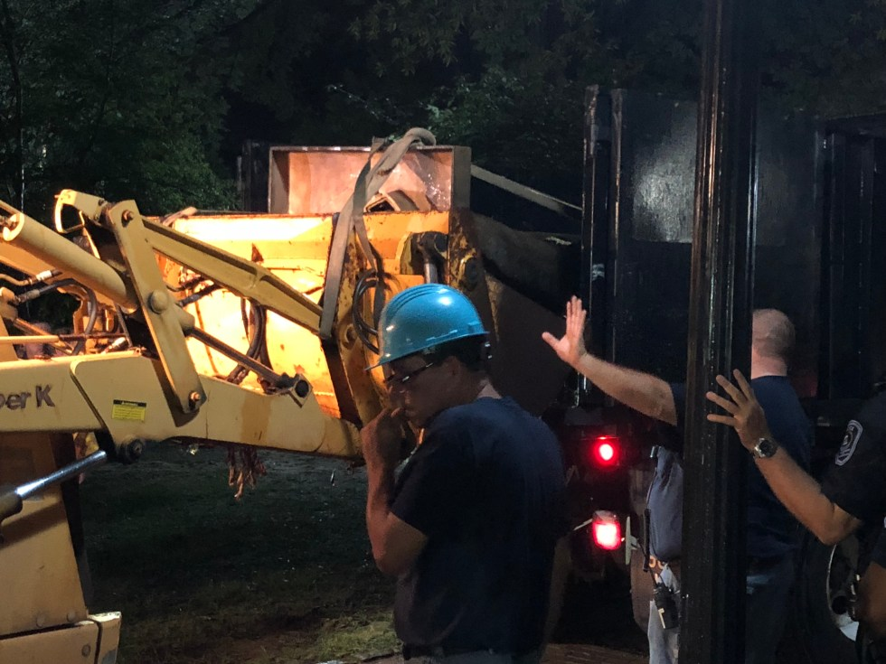 Silent Sam loaded into dump truck