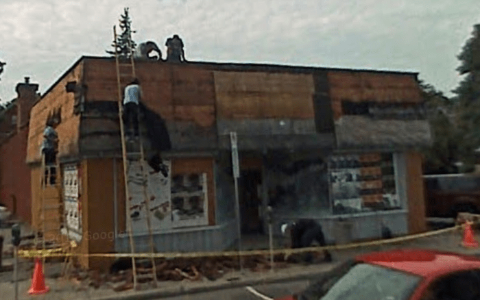 Workers restore the facade of 680 Bank following the departure of Olympic Sports Shop. Source: Google Maps (Street View, October 2007).