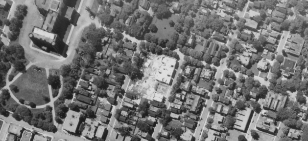 The lot in 1931 immediately following the subdivision of the lot. Here we see the Queen Victoria and Chamberlin Manor nearing completion. National Air Photo Library / uOttawa / A3332-71 May 26, 1931.