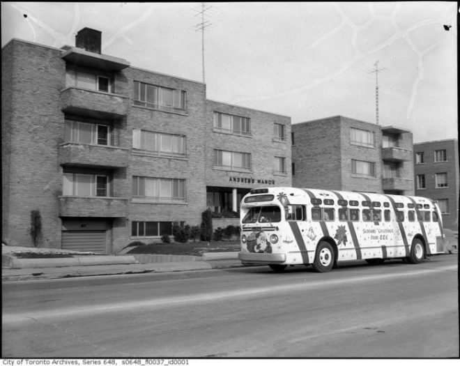 A TTC bus all decked out for Christmas in front of the Andrew's Manor Apartments, 896 Eglinton East, at Don Avon. 1958. Image: City of Toronto Archives, Fonds 1567, Series 648, File 37.