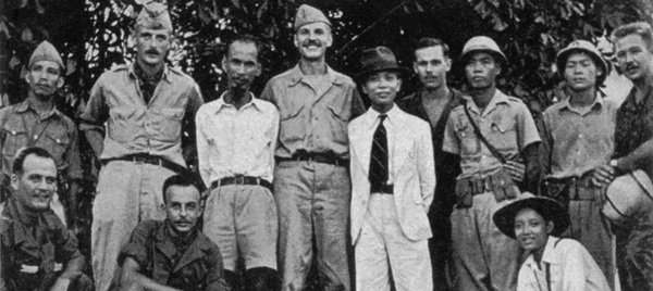 OSS Deer Team members pose with Viet Minh leaders Ho Chi Minh and Vo Nguyen Giap during training at Tan Trao in August 1945. Deer Team members standing, l to r, are Rene Defourneaux, (Ho), Allison Thomas, (Giap), Henry Prunier and Paul Hoagland, far right. Kneeling, left, are Lawrence Vogt and Aaron Squires. (Rene Defourneaux)
