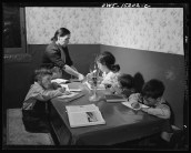 """""""Trampas, New Mexico. Mrs. Maclovia Lopez, can read and write English well; she also keeps the family books in the evening and helps the children with their homework,"""" January 1943"""