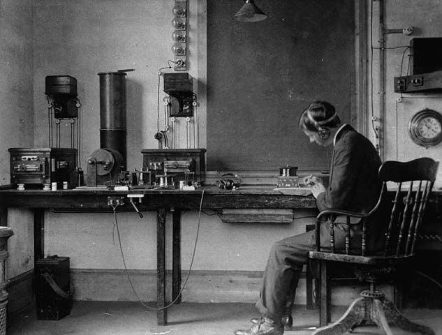 Donald Manson, an employee of the Marconi Wireless Company at work in 1905.