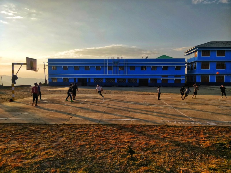 Thangkhul boys playing a game of basketball at Sacred Heart School in Ukhrul